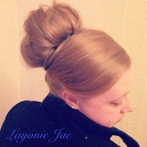 Hairstyle by Layonie jae using a hair donut