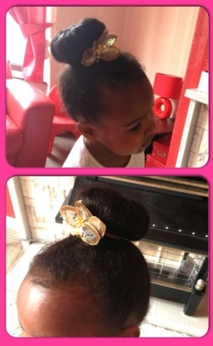 My daughter with her hair using a donut