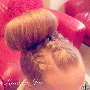 Hairstyle by Layonie Jae with a donut and braids